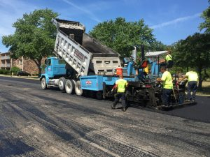 Ruston Paving installing asphalt at Clayton Arms Apartments in Rochester