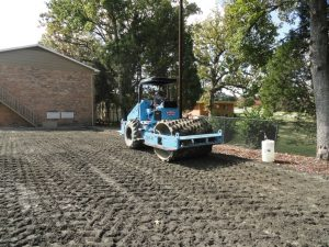 Sheepsfoot roller compacting stabilized subbase